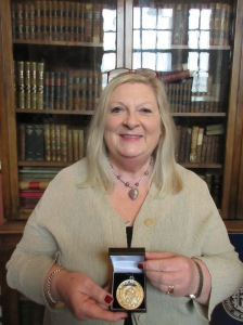 Marita with her Edmund Burke Medal from Trinity College Dublin